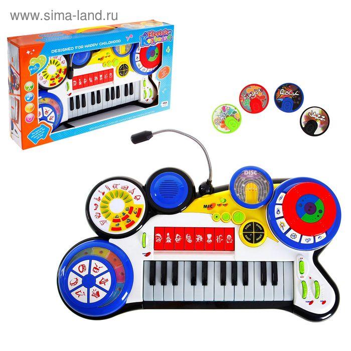 """Синтезатор """"Музыкальный микс"""", с микрофоном, звуковые эффекты работает от батареек"""
